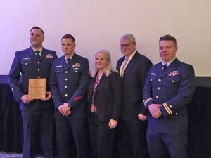 Members of the Coast Guard Cutter John McCormick alongside the parents of it's commanding officer, receive the 2017 Hopley Yeaton Cutter Excellence Award (small cutter) in conjunction with the 2018 Surface Navy Association National Symposium in Washington, D.C. Photo courtesy of United States Coast Guard.