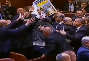 Chaos erupts in Israel's Knesset in response to Vice-President Pence's announcement of embassy move. One  dozen members of the chamber were ejected. Image-YouTube