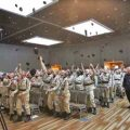 Cadets from the Alaska Military Youth Academy celebrate their graduation with a traditional hat toss.