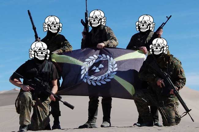 In a photo obtained by ProPublica, armed Atomwaffen members pose in the desert in Nye County, Nevada at their Death Valley Hate Camp in January 2018