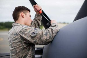 Airman 1st Class Trevor Galindo, crew chief for the 176th Maintenance Squadron, Alaska Air National Guard, removes a maintenance panel on an HC-130J at Joint Base Elmendorf-Richardson. (U.S. Air National Guard photo by Staff Sgt. Daniel Bellerive)