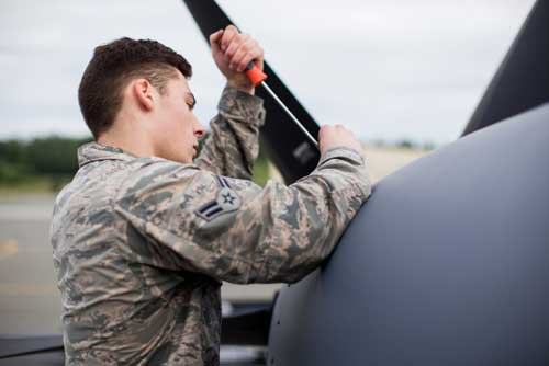 Airman 1st Class Trevor Galindo, crew chief for the 176th Maintenance Squadron, Alaska Air National Guard, removes a maintenance panel on an HC-130J at Joint Base Elmendorf-Richardson. (U.S. Air National Guard photo by Staff Sgt. Daniel Bellerive)