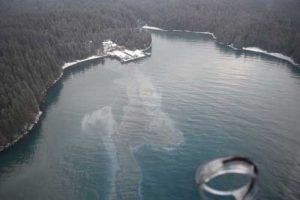 A Coast Guard Air Station Kodiak MH-60 helicopter crew and Marine Safety Detachment Kodiak pollution responders conduct an overflight in response to an oil spill in Shuyak Strait. USCG photo