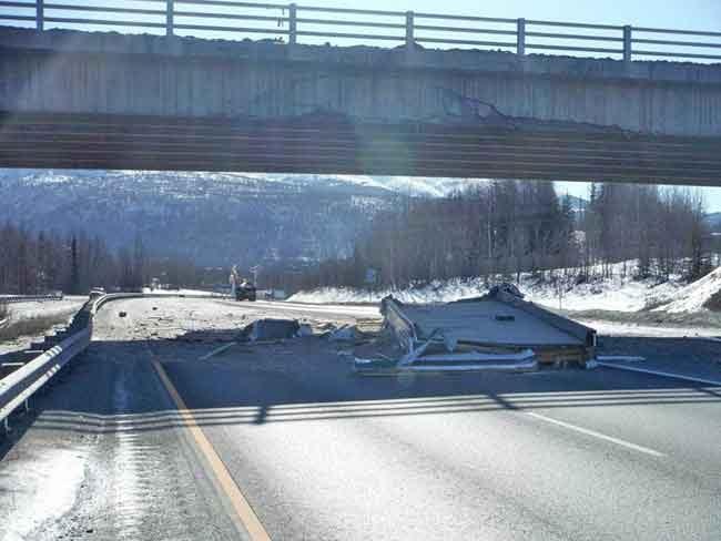 Damage at Artillery Road Bridge near Eagle River. Image-DOT