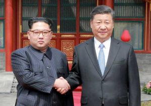 North Korean leader Kim Jong Un shakes hands with Chinese President Xi Jinping in Beijing, as he paid an unofficial visit to China, in this undated photo released by North Korea's Korean Central News Agency in Pyongyang, March 28, 2018.