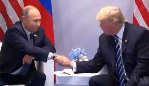 Trump and Putin shaking hands in July 2017 Hamburg press conference. VOA