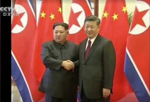 Chinese president Xi Jinping and North Korean leader Kim Jong Un shaking hands in Beijing. Image-Xinhua.