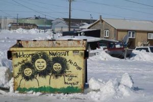 A welcoming dumpster greets visitors to Nuiqsut, a village of 411 people in an oil-rich region of Alaska's North Slope. Image-Ned Rozell