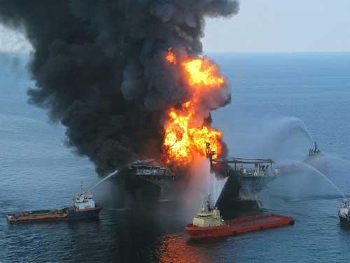 Platform supply vessels battle the blazing remnants of the off shore oil rig Deepwater Horizon. Image-USCG