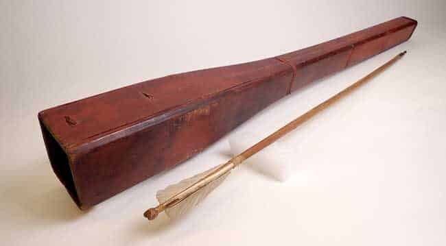 Photo: Nineteenth century wooden quiver and accompanying arrow. Gift of Father Cecil 'Sisinii' and Zoya Petellin King and their descendants. Photograph courtesy the Alutiiq Museum.
