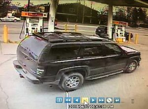 Black Chevy SUV used as a getaway vehicle in Shell gas station robbery on Tuesday. Image-APD