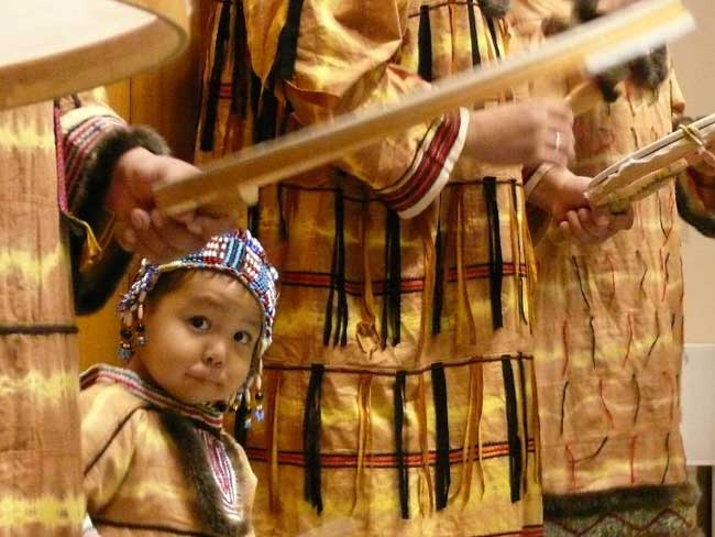 Child with dance group at Anchorage Museum. Image-ANN