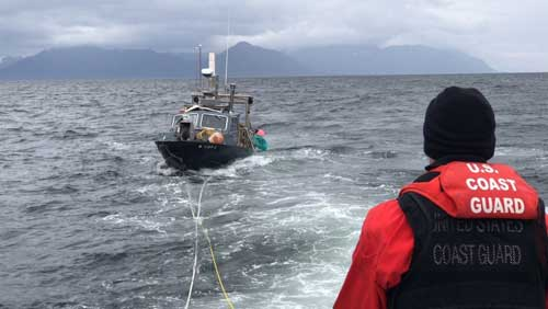 A Coast Guard Station Juneau 45-foot Response Boat–Medium crew assists the disabled 28-foot bar tender MINI B in Stephens Passage, near Holkham Bay, approximately 38 miles from downtown Juneau.U.S. Coast Guard courtesy photo.