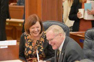 Senator Berta Gardner and Senator Dennis Egan share a laugh on the Senate Floor.