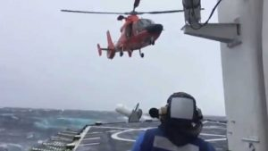USCG Dolphin helicopter landing on the cutter John Midgett during emergency medevac on May 6th. Image-USCG