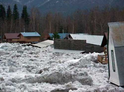 Ice blocks and flooding inundate Eagle in May 2009. Image-US National Park Service