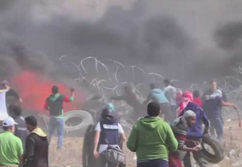Palestinians on the Gaza strip as fatal violence increases death toll on Monday. Image-Youtube screengrab