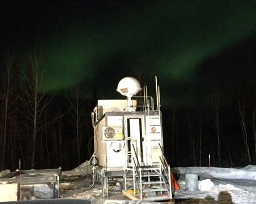 Fairbanks, Alaska, upper air building prepped and waiting for its first mission on April 19 to launch weather balloons, with Northern Lights dancing in the backdrop. (Credit: NOAA)
