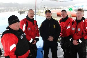 Crewmembers from the Coast Guard Cutter John McCormick pose with National Oceanic and Atmospheric Administration enforcement officer Tim Coffey. U.S. Coast Guard photo by Lt. j.g. Hailey Thompson.