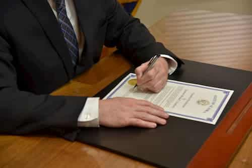 Governor Dunleavy signing proclamation for extending legislature session. Image-State of Alaska