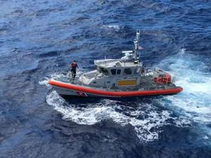 A 45-foot Response Boat-Medium boatcrew from Coast Guard Station Honolulu are shown conducting a search for five crewmembers aboard a downed Army UH-60 Black Hawk helicopter approximately two miles west of Ka'ena Point, Oahu.(U.S. Coast Guard photo/Released)