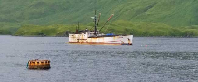 The fishing vessel Akutan in Captains Bay near Unalaska. A unified command was established to mitigate potential pollution and environmental impact from the vessel. U.S. Coast Guard photo
