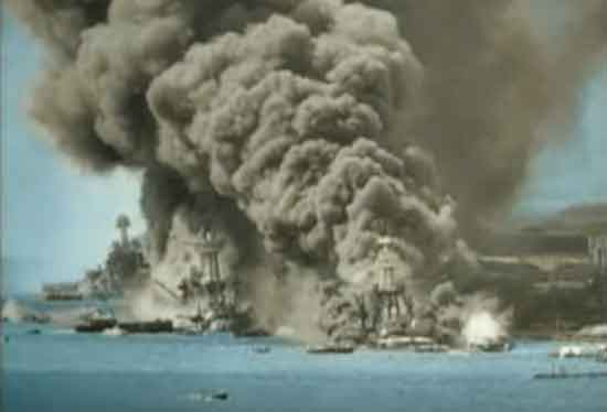 The tangled wreckage of ships line Battleship Row in the aftermath of the Japanese attack on December 7th, 1941.