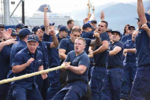 Crewmembers of the Coast Guard Cutter Hickory, homeported in Homer, Alaska, celebrate after winning the tug-o-war competition during the Buoy Tender Roundup Olympics at Coast Guard Station Juneau, Alaska, Aug. 17, 2016. Image-U.S. Coast Guard photo by Petty Officer 2nd Class Jon-Paul Rios
