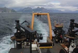 The Oscar Dyson departs a completed trawl location near the coastline of the Alaskan Peninsula. (Credit: NOAA)