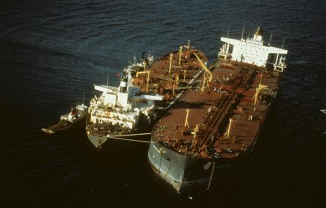 Exxon Valdez undergoing oil transfer operation following its grounding in Prince William Sound. Image-EVOSTC
