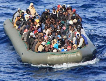 Migrants await rescue by Italian ships in February.