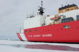 Coast Guard icebreaker Cutter Healy perches next to a shallow melt pond on the ice in the Chukchi Sea, north, of the Arctic Circle July 20, 2016. U.S. Coast Guard photo by Ensign Brian P. Hagerty/CGC Healy