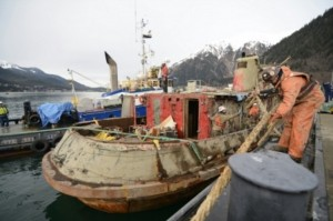 Tug Challenger is towed by Tug Norman O in Gastineau Channel near downtown Juneau, Alaska, Feb. 23, 2016. A Coast Guard Station Juneau 45-foot Response Boat-Medium follows the tow to enforce the safety zone around Tug Challenger. (U.S. Coast Guard photo by Petty Officer 3rd Class Greg Crane)
