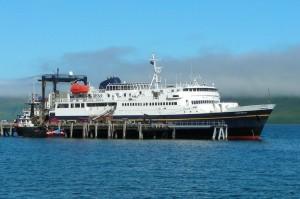 AMHS's M/V Tustumena docked in False Pass. Image-Shishaldin/ Creative Commons Attribution 3.0 Unported license.