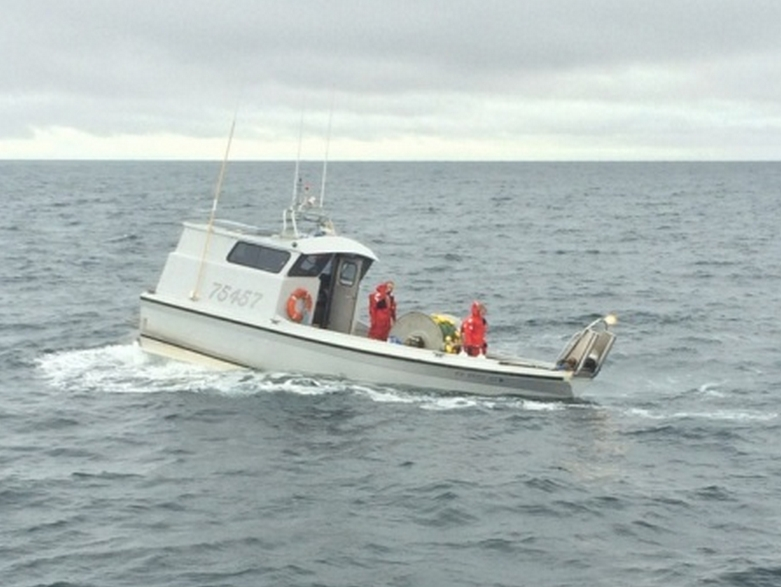 A Coast Guard Station Valdez boatcrew responds to a 30-foot fishing vessel taking on water near Valdez, Alaska, July 27, 2015. The fishing vessel Fishing Time had a four-inch crack in the hull that the Station Valdez boatcrew assisted with repairing before escorting the two boaters to Cordova. (U.S. Coast Guard photo)