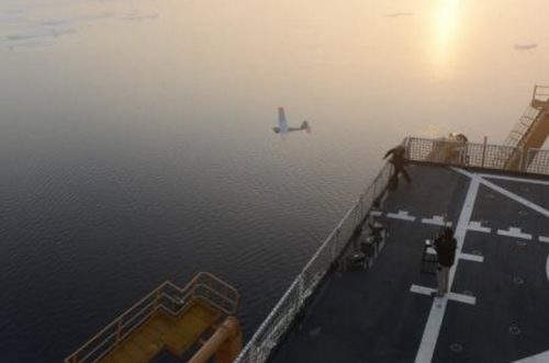 "OAST GUARD CUTTER HEALY, Arctic Ocean – Coast Guard and National Oceanic and Atmospheric Administration researchers successfully landed an unmanned aircraft system on the flight deck of Coast Guard Cutter Healy Monday, marking the first time a UAS has completed a take-off and landing aboard a Coast Guard icebreaker. UAS operators from AeroVironment, designers of the Puma All Environment UAS, working alongside researchers from the Coast Guard Research and Development Center and NOAA made necessary adjustments following several unsuccessful attempts to land the Puma AE on the icebreaker's flight deck. High winds, heavy fog, and icing conditions delayed further attempts until Monday night when skies cleared enough for another attempt. UAS operators came close to landing the system on the initial attempt before managing three successful landings. The last was a perfect landing onto the center of the flight deck. Researchers and crew aboard the Healy left Seward, Alaska, Aug. 8 to conduct testing of the Puma AE and other technologies for use as oil spill tracking tools. The UAS is equipped with an electro-optical and infrared camera plus illuminator on a lightweight mechanical gimbaled payload allowing its operator to keep constant watch over the device's target. The Coast Guard RDC and NOAA hope to utilize UAS and other unmanned technologies to perform monitoring and search operations in the Arctic and other areas where hazardous conditions might otherwise place human observers in increased danger. ""The Coast Guard and its partners realize the value of exploring technologies like UAS to improve our ability to respond in the Arctic,"" said Rich Hansen, RDC Chief Scientist traveling aboard Healy. ""Unmanned systems have great potential for tracking spills, so responders can avoid unnecessary risk while safeguarding our seas."" The Coast Guard Research and Development Center is based in New London, Conn., and aids the Coast Guard by providing research and evaluations of technologies and equipment with the potential for enhancing its ability to carry out its missions. Coast Guard Cutter Healy is a 420-foot icebreaker homeported in Seattle, Wash. The icebreaker's crew conducts the Coast Guard's traditional missions including search and rescue, environmental protection and enforcement of laws and treaties while performing their primary mission of assisting with scientific research in polar regions. Coast Guard photo by Petty Officer 1st Class Shawn Eggert."