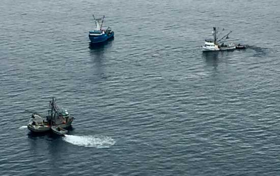 Alerted by an Urgent Marine Broadcast, the crews of two good Samaritan vessels, the Rocky B and the Remedy, assist the crew of the fishing vessel Kodiak Sockeye after the vessel began taking on water near Knowles Bay, Prince William Sound
