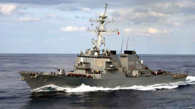 The guided missile destroyer USS John S. McCain approaches the USS Kitty Hawk in this 2003 photo. Image-USDoD