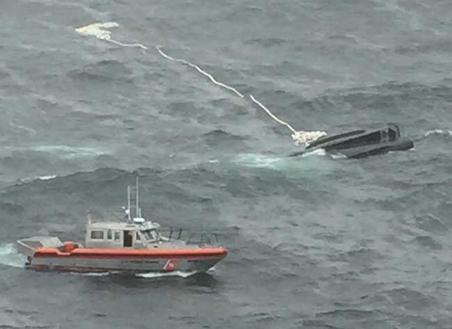 A Coast Guard 38-foot smallboat crew from Aids to Navigation Team Kodiak, Alaska, approaches the capsized Miss Destinee during a search for a missing man and woman in Marmot Bay near Kodiak. U.S. Coast Guard photo provided by Air Station Kodiak.