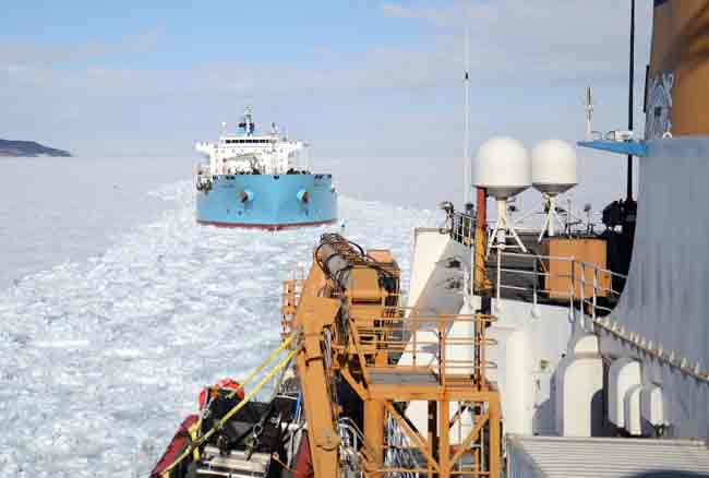 The USCGC Polar Star escorts a tanker through the sea ice of McMurdo Sound. Credit: U.S. Coast Guard
