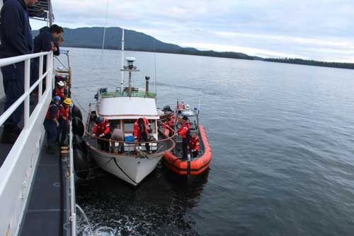 A Coast Guard small-boat crew transfers tow of the 36-foot vessel Viking Queen to the Cutter John McCormick in Elena Bay, 50 miles southwest of Kake. USCG photo
