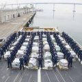 Coast Guardsmen aboard the USCGC Waesche (WMSL 751), homported in Alameda, California, stand alongside approximately 18 tons of cocaine in San Diego. (U.S. Coast Guard photo by Petty Officer 3rd Class Davonte Marrow)