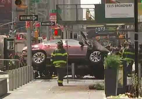 The burgundy Honda involved in the Times Square vehicle-pedestrian incident came to rest on the steel barricades near Planet Hollywood.