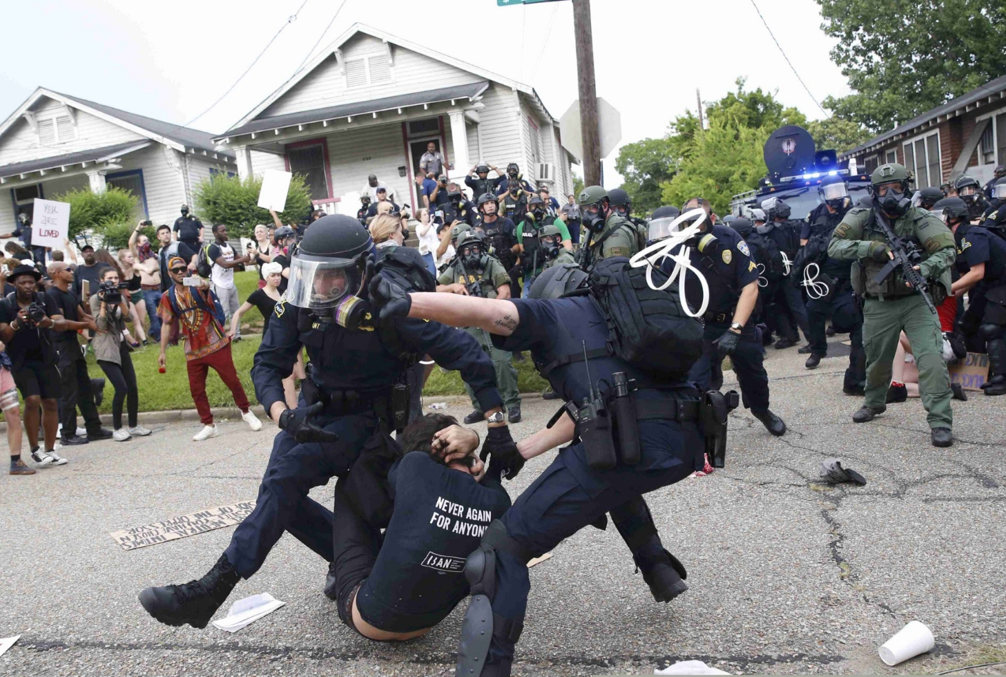 Police scuffle with a demonstrator as they try to apprehend him during a rally in Baton Rouge, Louisiana July 10th. Image-Reuters/Shannon Stapleton