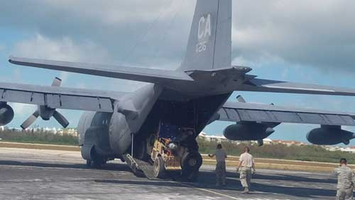 Guardsmen with the 176th Wing unloading a HC-130 in Florida last month. Image-DVIDS