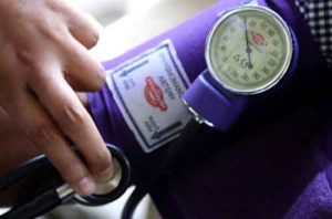 Checking the blood pressure by using a sphygmomanometer and stethoscope. Jesse K. Alwin, U.S. Marine Corps