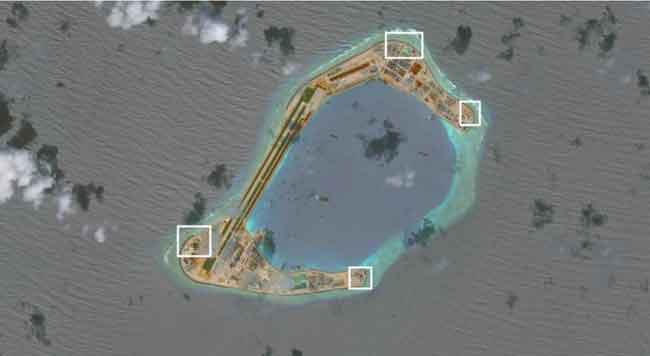 A satellite image shows what CSIS Asia Maritime Transparency Initiative says appears to be anti-aircraft guns and what are likely to be close-in weapons systems (CIWS) on the artificial island Subi Reef in the South China Sea in this image released on Dec. 13, 2016. Image-CSIS Asia Maritime Transparency Initiative