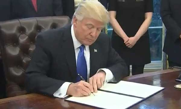 President Trump signing Executive Orders in Oval Office. Image-CSPAN video screengrab