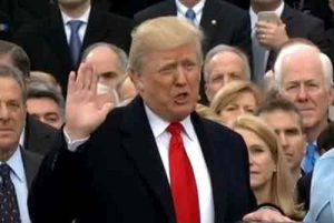 Donald Trump being sworn in as president of the United States. Image-VOA