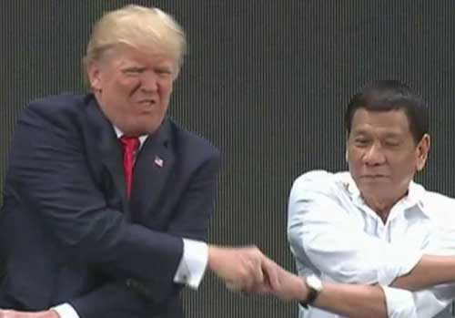 Presidents Trump and Duterte in a complicated handshake. Image-Screenshot/CBS